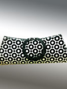 Pretty clutch purse has beautiful black rings pattern on white surface. Metal handle covered with black rexin. Its is handy to carry and casual purpose clutch. Slight Color variations are possible due to differing screen and photograph resolutions.