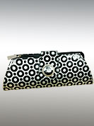 Try out this year top trends collection. This clutch has black circles with flap. Silver metal button on flap is graceful. It is handy to carry and impress to all in everywhere. This purse used in parties. Slight Color variations are possible due to differing screen and photograph resolutions.