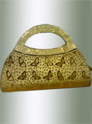 Be stylish with this golden butterfiy printed purse. This is nicely designed with handle and unique shape. It is handy to carry and impress to all in everywhere. This purse used in parties. Slight Color variations are possible due to differing screen and photograph resolutions.