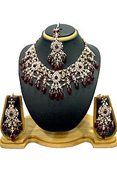 Classic and elegant necklace creations offered are a mix of traditional and ultramodern designs. A beautiful necklace designed in drops pattern studded with diamonds, maroon beads and hanging crystal moti. A pair of matching earrings and maangtika embraces with this necklace. Keep away from water, sweat and perfume. Slight Color variations are possible due to differing screen and photograph resolution.