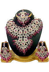 Breathtaking necklace set designed in a very unique approach. This beautiful pink wedding and bridal purpose necklace awesomely crafted with white and pink diamonds studded drop frame with hanging crystal moti. A pair of matching earrings and beautiful maangtika embraces with this necklace. Keep away from water, sweat and perfume. Slight Color variations are possible due to differing screen and photograph resolution.