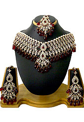 The necklace set looks excellent with delicate & elegant work. Diamonds studded drops frames with maroon stone and hanging crystal moti work used in this necklace. It's a wedding purpose set. A pair of matching earrings and beautiful maangtika embraces with this necklace. Keep away from water, sweat and perfume. Slight Color variations are possible due to differing screen and photograph resolution.
