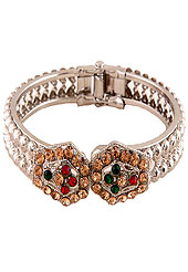 Classic, Elegant and timeless diamond bangle. This hexagonal patterned bangle is studded with white, red, fawn and green diamonds. This diamond base bangle is adjustable. Slight Color variations are possible due to differing screen and photograph resolution.