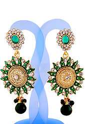 Go with this earring designed in a Sun shaped frames which are nicely designed with diamonds, hanging stones and enamel work. The base frame of earring is made with alloy metal. Keep away from water, sweat and perfume. Slight Color variations are possible due to differing screen and photograph resolution.