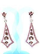 Create striking glance with this earring intended in a rhombus shaped frames which are nicely designed with Pink and Maroon Diamonds work. The base frame of earring is made with alloy metal. Keep away from water, sweat and perfume. Slight Color variations are possible due to differing screen and photograph resolution.