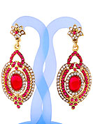 A pair of earrings looks excellent with delicate & elegant work. Earrings are nicely crafted with pink and white diamonds studded oval shaped frame with pink stone in centre. The base frame of earring is made with alloy metal. It's used for wedding and party purpose. Keep away from water, sweat and perfume. Slight Color variations are possible due to differing screen and photograph resolution.