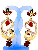 Each design has been carefully crafted keeping in mind the taste of today's Indian woman. A classic earring is beautified with diamond and crystal moti work. Peacock shape frames studded with white, green and red diamonds. Hanging moti and stone in centre is the main point of attraction. Keep away from water, sweat and perfume. Slight Color variations are possible due to differing screen and photograph resolution.