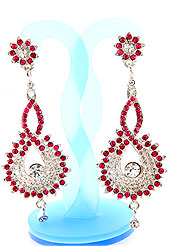 Match your outfits with this earring designed in a floral shape, so that your glamour goes beyond any comparison on your special day. A Pair of earring s nicely crafted with Pink and white diamonds. The base frame of earring is made with alloy metal. Keep away from water, sweat and perfume. Slight Color variations are possible due to differing screen and photograph resolution.