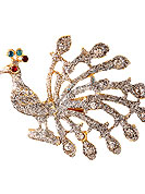 Classic and elegant brooch creations offered are a mix of traditional and ultramodern designs. This beautiful peacock patterned pink saree pin is stuuded with diamonds on alloy metal frame. Red, Blue and Maroon diamonds create centre of attraction. Keep away from water, sweat and perfume. Slight Color variations are possible due to differing screen and photograph resolution.