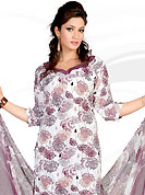 Envelope yourself in classic look with this charming suit. This Suit has beautiful printed kameez which is crafted with floral print work. Color combination of suit is fascinating and make you trendy look. This casual wear drape made with crepe fabric. Matching dupatta and churidar is available. Slight Color variations are possible due to differing screen and photograph resolutions.