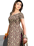 Be the cynosure of all eyes with this wonderful  casual wear in flattering colors and combinations. This Suit has beautiful printed kameez which is crafted with spiral print work. Color combination of suit is fascinating and make you trendy look. This casual wear drape made with crepe fabric. Matching dupatta and churidar is available. Slight Color variations are possible due to differing screen and photograph resolutions.
