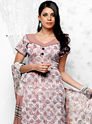 Emblem of fashion and beauty, each piece of our range of printed suit is certain to enhance your look as per today's trends. This Suit has beautiful printed kameez which is crafted with spiral, circle and leaf print work. Color combination of suit is fascinating and make you trendy look. This casual wear drape made with crepe fabric. Matching dupatta and churidar is available. Slight Color variations are possible due to differing screen and photograph resolutions.