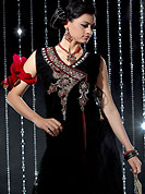 Era with extension in fashion, style, Grace and elegance have developed grand love affair with this ethnical wear. This black and red readymade churidar kameez is embllished with beautiful embroidery patch work on neckline. Embroidery is done sequins, cutdana and stone work. Stylish neck pattern is eye catching to impress all. Matching dupatta and churidar is available with this suit. This drape crafted with net fabric. It's a wonderful party wear suit. Slight color variations are possible due to differing screen and photograph resolutions.