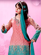 The very silhouette and styling of this outfit proves quiet flattering for most body types and renders a rather grand and majestic appeal. This well-designed kameez nicely designed with embroidery patch work. Embroidery is done with applique, beads and cotton lace work in form of floral motifs. Embroidery on kameez is highlighting the beauty of this suit. Matching dupatta and churidar come along with this suit. This beautiful party wear suit is made with chiffon fabric. Slight Color variations are possible due to differing screen and photograph resolutions.