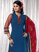 The most beautiful refinements for style and tradition. This blue and maroon A-Line kameez has beautiful embroidered patch work done with resham, zari and dupion work in form of floral motifs. Embroidery on kameez and dupatta is highlighting the beauty of this suit. Color combination of this suit is captivating and makes an impression to all. Santoon churidar, chiffon dupatta and net sleeves come along with this suit. This beautiful party wear made with georgette fabric. Slight Color variations are possible due to differing screen and photograph resolutions.