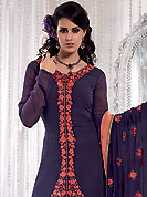 Envelope yourself in classic look with this charming suit. This navy blue and light orange A-Line kameez has beautiful embroidered patch work done with resham and dupion work in form of floral motifs. Embroidery on kameez and dupatta is highlighting the beauty of this suit. Color combination of this suit is captivating and makes an impression to all. Santoon churidar and georgette dupatta come along with this suit. This beautiful party wear made with georgette fabric. Slight Color variations are possible due to differing screen and photograph resolutions.