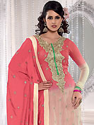 Embroidered suits are the best choice for a girl to enhance her feminine look. This peach and cream A-Line kameez has beautiful embroidered patch work done with resham, zari, sequins and dupion work in form of floral motifs. Embroidery on kameez and dupatta is highlighting the beauty of this suit. Santoon churidar and georgette dupatta come along with this suit. This beautiful party wear made with georgette fabric. Slight Color variations are possible due to differing screen and photograph resolutions.
