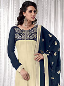 You can be sure that ethnic fashions selections of clothing are taken from the latest trend in today's fashion. This cream and navy blue anarkali kameez has beautiful embroidered patch work on neckline and border done with resham, zari and dupion work in form of floral motifs. Embroidery on kameez and dupatta is highlighting the beauty of this suit. Color combination of this suit is captivating and makes an impression to all. Santoon churidar and georgette dupatta come along with this suit. This beautiful party wear made with georgette fabric. Slight Color variations are possible due to differing screen and photograph resolutions.