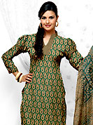 Let your personality articulate for you with this amazing suit. This Suit has beautiful printed kameez which is crafted with paisley pattern and patch work. This casual wear drape made with cotton fabric. Matching dupatta and churidar is available. The entire ensemble makes an excellent wear. Slight Color variations are possible due to differing screen and photograph resolutions.