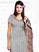 The popularity of this dress comes from the fact that it showcases the beauty modesty as well as exquisitely. This Suit has beautiful printed kameez which is crafted with floral and geometrical pattern. This casual wear drape made with cotton fabric. Contrasting maroon churidar and dupatta is available. The entire ensemble makes an excellent wear. Slight Color variations are possible due to differing screen and photograph resolutions.