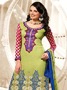 Embroidery suits are the best choice for a girl to enhance her feminine look. This suit with dupatta is enrapturing. This kameez is embellished with beautiful floral embroidery work on neckline and bottom done with resham and zari work with fabric border. This suit is made with crepe fabric. Matching dupatta and churidar is available with this suit. Slight Color variations are possible due to differing screen and photograph resolutions.
