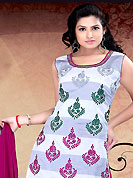 Outfit is a novel ways of getting yourself noticed. The dazzling light grey and white readymade salwar kameez have amazing embroidery patch work. Embroidery is done with resham, zari, stone and gota patti work in form of floral motifs. Beautiful embroidery on kameez is stunning. The entire ensemble makes an excellent wear. Contrasting magenta salwar and dupatta is available with this suit. This drape material is cotton fabric. Slight Color variations are possible due to differing screen and photograph resolutions.