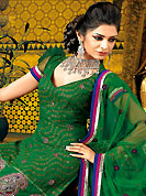 The color range from natural shades looks ravishing. The dazzling deep green A-Line kameez have amazing embroidery and patch work. Embroidery is done with resham, zari and stone work. Beautiful embroidery work on kameez is stunning. The entire ensemble makes an excellent wear. Matching churidar and dupatta is available with this suit. This beautiful wedding wear suit is made with viscose fabric. Slight Color variations are possible due to differing screen and photograph resolutions.