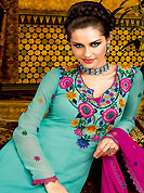 This season dazzle and shine in pure colors. The dazzling shaded sea green A-Line kameez have amazing embroidery and patch work. Embroidery is done with resham and lace work. Beautiful embroidery work on kameez is stunning. The entire ensemble makes an excellent wear. Contrasting deep pink churidar and dupatta is available with this suit. This beautiful wedding wear suit is made with faux georgette fabric. Slight Color variations are possible due to differing screen and photograph resolutions.