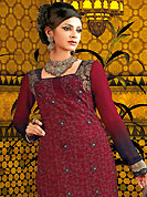Attract all attentions with this embroidered suit. The dazzling maroon A-Line kameez have amazing embroidery and patch work. Embroidery is done with resham, zari and gota lace work. Beautiful embroidery work on kameez is stunning. The entire ensemble makes an excellent wear. Matching churidar and dupatta is available with this suit. This beautiful wedding wear suit is made with faux georgette fabric. Slight Color variations are possible due to differing screen and photograph resolutions.