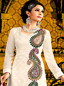 Emblem of fashion and beauty, each piece of our range of embroidered suit is certain to enhance your look as per today's trends. The dazzling white A-Line kameez have amazing embroidery and patch work. Embroidery is done with resham, beads and brasso work. Beautiful embroidery work on kameez is stunning. The entire ensemble makes an excellent wear. Matching churidar and dupatta is available with this suit. This beautiful wedding wear suit is made with faux georgette fabric. Slight Color variations are possible due to differing screen and photograph resolutions.