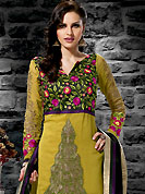 Ultimate collection of embroidered suits with fabulous style. The dazzling golden yellow georgette churidar suit have amazing embroidery and patch work. Embroidery is done with resham and zari work in form of floral motifs. Embroidery on kameez is highlighting the beauty of this suit. Beautiful embroidery work on kameez is stunning. Contrasting magenta churidar and black dupatta come along with this suit. Accessories shown in the image is just for photography purpose. Slight Color variations are possible due to differing screen and photograph resolutions.