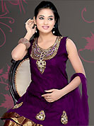 Get ready to sizzle all around you by sparkling suit. The dazzling deep purple net readymade churidar suit have amazing embroidery patch work is done with zari, sequins, stone, cutdana and lace work in form of floral motifs. Color combination of this suit is fascinating and makes you fashionable look. Matching butter crepe churidar and net dupatta is available with this suit. Slight Color variations are possible due to differing screen and photograph resolutions.