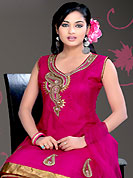 Dreamy variation on shape and forms compliment your style with tradition. The dazzling deep pink net readymade churidar suit have amazing embroidery patch work is done with zari, sequins, stone, cutdana and lace work in form of floral motifs. Color combination of this suit is fascinating and makes you fashionable look. Matching butter crepe churidar and net dupatta is available with this suit. Slight Color variations are possible due to differing screen and photograph resolutions.