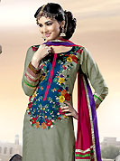 Take the fashion industry by storm in this beautiful embroidered suit. The dazzling dark grey salwar kameez have amazing embroidery and patch work. Embroidery is done with resham, zari and gota patti work in form of floral motifs. Embroidery on kameez is highlighting the beauty of this suit. Matching churidar and contrast deep pink dupatta come along with this suit. This drape material is georgette fabric. This beautiful party wear suit is made with georgette fabric. Accessories shown in the image is just for photography purpose. Slight Color variations are possible due to differing screen and photograph resolutions.