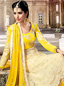Get ready to sizzle all around you by sparkling suit. The dazzling beige and yellow anarkali churidar suit have amazing embroidery and patch work. Embroidery is done with resham, zari and sequins work in form of floral motifs. Embroidery on kameez is highlighting the beauty of this suit. Matching churidar and dupatta come along with this suit. This beautiful party wear suit is made with net fabric. The entire ensemble makes an excellent wear. Accessories shown in the image is just for photography purpose. Slight Color variations are possible due to differing screen and photograph resolutions.