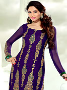 You can be sure that ethnic fashions selections of clothing are taken from the latest trend in today's fashion. This violet georgette kameez has beautiful embroidered and patch work. Embroidery is done with resham, zari and sequins work in form of traditional motifs. Embroidery on kameez is highlighting the beauty of this suit. Contrasting green santoon churidar and matching chiffon dupatta is available with this suit. It's a wonderful party wear suit. Slight color variations are possible due to differing screen and photograph resolutions.