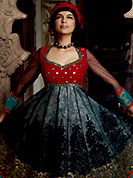 The popularity of this dress comes from the fact that it showcases the beauty modesty as well as exquisitely. The dazzling black and red net anarkali churidar suit have amazing embroidery and patch work. Embroidery is done with resham, sequins, applique and gota patti work in form of floral motifs. Embroidery on kameez is highlighting the beauty of this suit. Matching crepe churidar, net dupatta and shimmer brasso lining come along with this suit. Accessories shown in the image is just for photography purpose. Slight Color variations are possible due to differing screen and photograph resolutions.