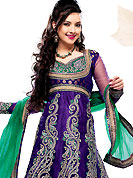 Attract all attentions with this embroidered suit. The dazzling violet net anarkali churidar suit have amazing embroidery and patch work. Embroidery is done with self weaving, resham and zari work in form of floral motifs. Embroidery on kameez is highlighting the beauty of this suit. Contrasting green churidar and net dupatta come along with this suit. This semi stitch kameez can be customized upto 44 inches. Slight Color variations are possible due to differing screen and photograph resolutions.