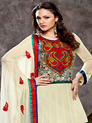 When designs meet innovation, its nothing less than a classic moment. The dazzling cream faux georgette churidar suit have amazing embroidery patch work. Embroidery is done with resham and zari work in form of floral motifs. Beautiful embroidery work on kameez is stunning. Contrasting dark blue churidar and matching dupatta is available with this suit. Accessories shown in the image is just for photography purpose. Slight Color variations are possible due to differing screen and photograph resolutions.
