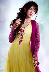 Take a look on the changing fashion of the season. This yellow chiffon churidar suit have amazing embroidery patch work is done with resham, zari and sequins work. Embroidery on kameez is highlighting the beauty of this suit. Contrasting dark magenta santoon churidar and chiffon dupatta come along with this suit. Slight Color variations are possible due to differing screen and photograph resolutions.