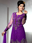 Ultimate collection of embroidered suits with fabulous style. The dazzling purple net readymade churidar suit have amazing embroidery patch work is done with resham, zari and gota patti work. The entire ensemble makes an excellent wear. Matching cotton crepe churidar and net dupatta is available with this suit. Slight Color variations are possible due to differing screen and photograph resolutions.