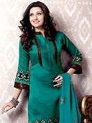 When designs meet innovation, its nothing less than a classic moment. The dazzling turquoise green banarasi silk churidar suit have amazing embroidery patch work is done with resham and zari work. Contrasting maroon churidar and matching dupatta is available with this suit. Slight Color variations are possible due to differing screen and photograph resolutions.