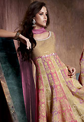 Outfit is a novel ways of getting yourself noticed. The dazzling fawn and light pink chiffon anarkali readymade churidar suit have amazing embroidery patch work is done with resham work. The entire ensemble makes an excellent wear. Contrasting dark mauve churidar and dupatta is available with this suit. Slight Color variations are possible due to differing screen and photograph resolutions.
