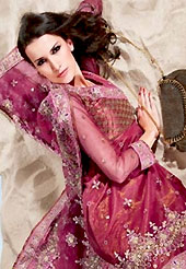 Let your personality articulate for you with this amazing embroidered suit. The dazzling burgundy churidar suit have amazing embroidery patch work is done with resham work. The entire ensemble makes an excellent wear. Matching churidar and dupatta is available with this suit. Slight Color variations are possible due to differing screen and photograph resolutions.