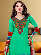 Take the fashion industry by storm in this beautiful embroidered suit. The dazzling green faux crepe churidar suit have amazing embroidery patch work is done with resham and lace work. The entire ensemble makes an excellent wear. Matching churidar and dupatta is available with this suit. Slight Color variations are possible due to differing screen and photograph resolutions.