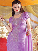 Ultimate collection of embroidered suits with fabulous style. The dazzling mauve salwar kameez have amazing embroidery patch work is done with sequins, zardosi and stone work. The entire ensemble makes an excellent wear. Matching salwar and dupatta is available with this suit. Slight Color variations are possible due to differing screen and photograph resolutions.