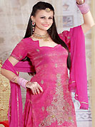 Get ready to sizzle all around you by sparkling suit. The dazzling pink salwar have amazing embroidery patch work is done with zari, sequins and stone work. The entire ensemble makes an excellent wear. Matching salwar and dupatta is available with this suit. Slight Color variations are possible due to differing screen and photograph resolutions.