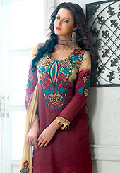 Take the fashion industry by storm in this beautiful embroidered suit. This beautiful fawn and burgundy salwar kameez is nicely designed with embroidery patch work is done with resham and lace work in form of floral motifs. Embroidery on kameez is highlighting the beauty of this suit. Matching fawn salwar and dupatta come along with this suit. Slight Color variations are possible due to differing screen and photograph resolutions.