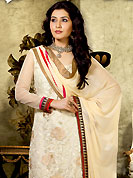 Try out this year top trend, glowing, bold and natural collection. The dazzling cream net churidar suit have amazing embroidery patch work is done with self weaving zari, resham and lace work. The entire ensemble makes an excellent wear. Contrasting maroon churidar and matching dupatta is available with this suit. Slight Color variations are possible due to differing screen and photograph resolutions.