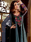 Breathtaking collection of designer suits with stylish embroidery work and fabulous style. The dazzling black and grey net kameez have amazing embroidery patch work is done with resham, zari and stone work in form of floral motifs. Embroidery work on kameez is stunning. This is perfect party wear suit. The entire ensemble makes an excellent wear. Matching black churidar and double dye dupatta is available with this suit. Slight Color variations are possible due to differing screen and photograph resolutions.